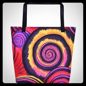 Canvas tote with vibrant spiral design.